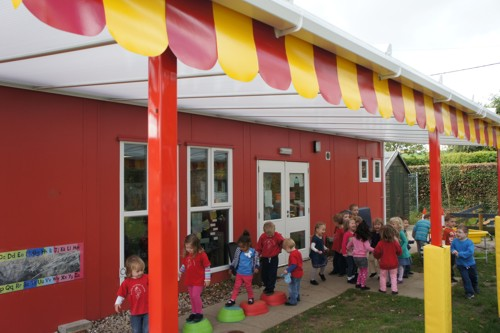 The Coniston Wall Mounted Canopy installed at Bramford Pre-School Playgroup in Bramford, Suffolk