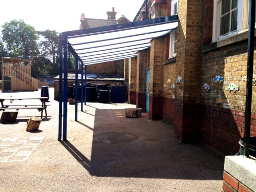 A Coniston Wall Mounted Canopy installed at Chase Side Primary School Enfield, Middlesex