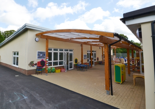 Wooden Canopy St Joseph's Catholic Primary School, West Sussex - Curved Glulam Timber Canopy - Able Canopies Ltd.