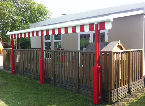 The Coniston Wall Mounted Canopy with The Rainbow Package Installed at Buttercups Pre School in Balsham, Cambridgeshire