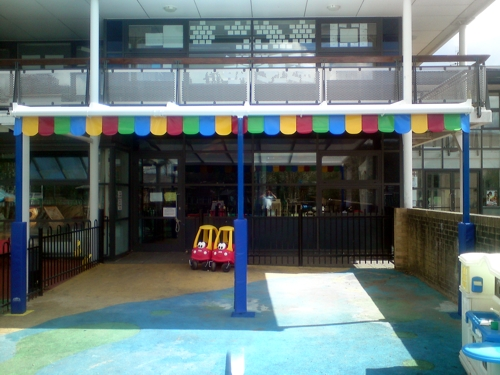 The Coniston Wall Mounted Canopy with The Rainbow Package Installed at Bourne Childrens Centre in Kenley, Surrey