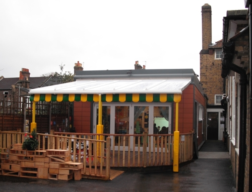 The Coniston Wall Mounted Canopy with The Rainbow Package Installed at Elm Wood Primary School in London