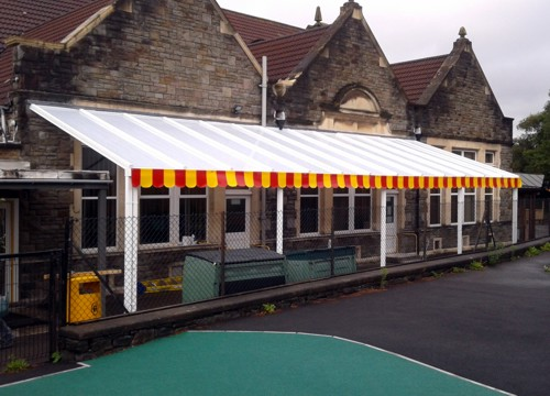 The Coniston Wall Mounted Canopy with The Rainbow Package Installed at Parson Street Primary School in Bristol