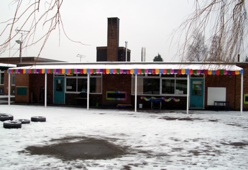 The Coniston Wall Mounted Canopy with The Rainbow Package Installed at Stafford Leys Community Primary School in Leicestershire