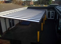 Holt Community Primary School - Wall Mounted Canopy